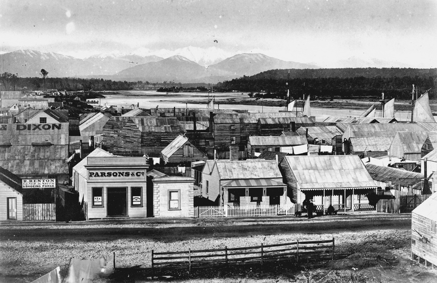 Hokitika c.1870 Revell Street with ships at the wharf in background. James Ring (Alexander Turnbull Library, National Library of New Zealand)