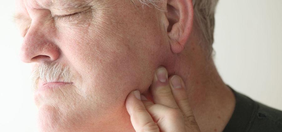 Kiefergelenkerkrankungen sind oft die Ursache für körperliche Schmerzen – der Zahnarzt hilft