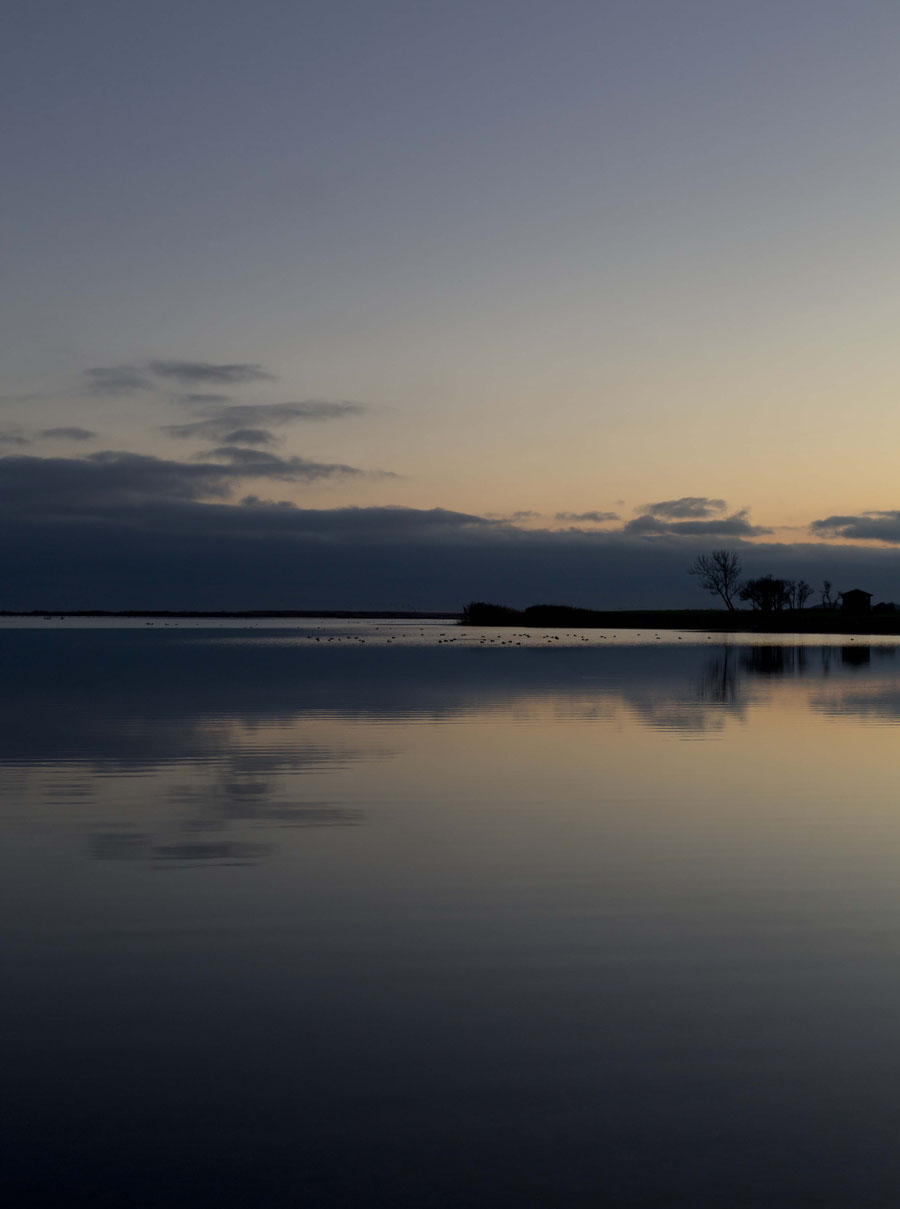 The shore in Kuressaare, Saaremaa, Estonia, during sunset and with a clear sky.