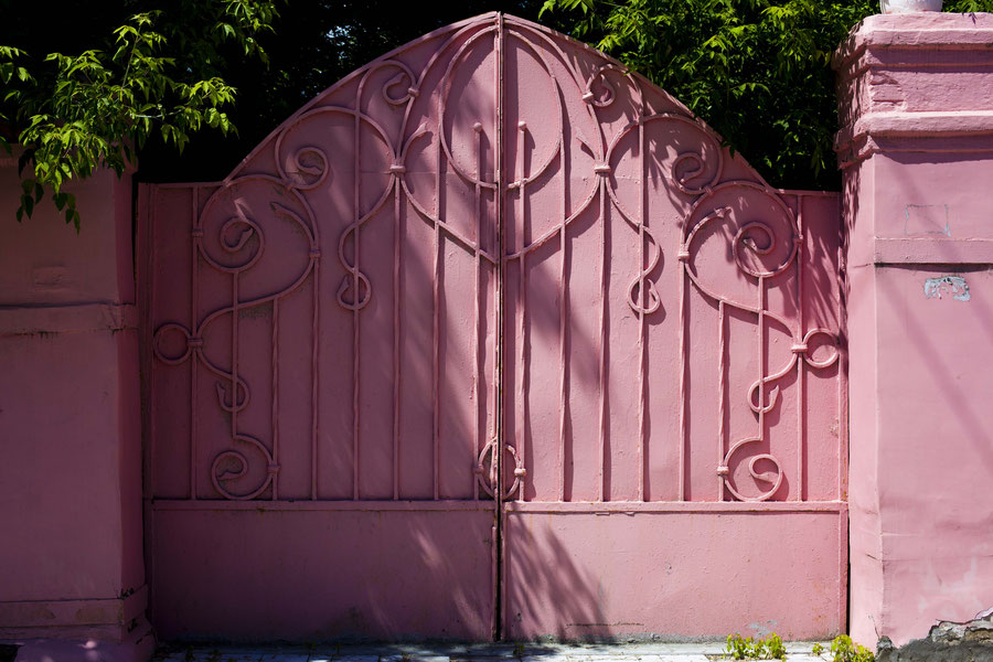Pink gate in the summer heat, Samara, Russia