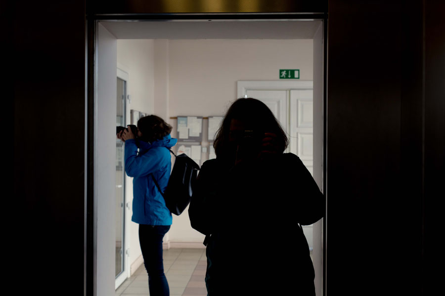 Parallel photography, silhouettes in elevator door
