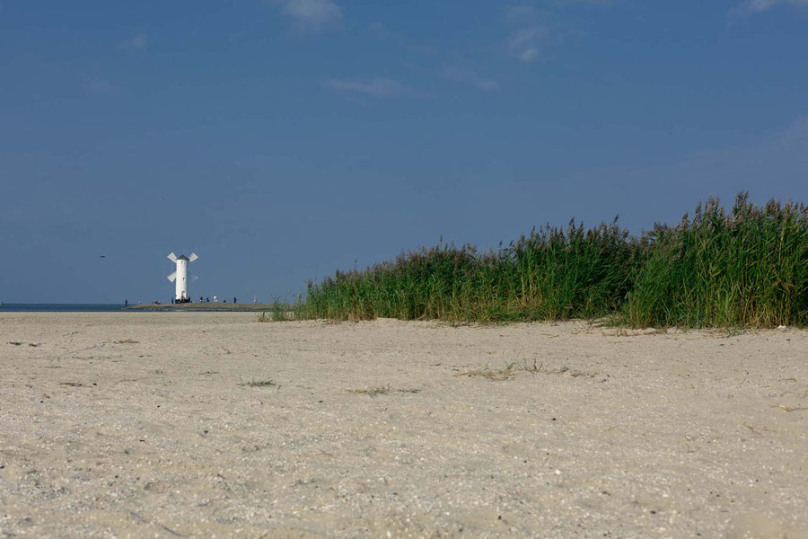 Windmill on the outmost part of the beach in Swinouscije