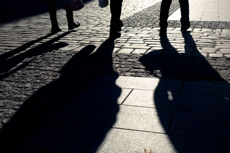 Long shadows of passersby in Tallinn, Estonia.