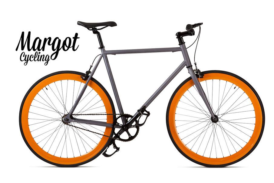 En la foto, la fixed bike Margot Lampo. Muy agradable la combinación gris plomo del cuadro  con los aros naranja de 43mm de perfil.