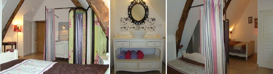 Grande chambre familiale aux couleurs romantiques, un lit à baldaquin et un paravent