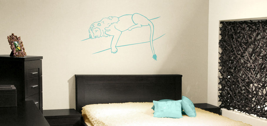 Sleeping Lion on a branch in turquoise vinyl. This king on the jungle is resting above a bed adding an accent of colour to the room. This sticker design comes in many colour options to suit any room in need of a big cat.