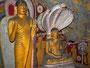Kunstvolle Symbolik im Höhlentempel von Dambulla