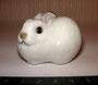 Кролик белый 1980 гг. Модель 1950г. Е.И Чарушин. Роспись подглазурная полихромная, высота 3, 5 см. Марка: ЛФЗ красная.