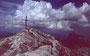 Gipfelkreuz der Mohnenfluh. Aufziehendes  Gewitter.