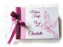 Schraubalbum zur Taufe - 21cmx16cm, 25 Blatt weiß, mit individueller Grafik (viele Taufsymbole in Form einer Taube mit Ölzweig) bedruckter Einband und Druck des Taufspruches im Buch, in den Farben rosa, weiß und fuchsia.