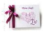 Foto-Gästebuch zur Taufe - 21cmx16cm, 20 Blatt weiß, mit individueller Grafik (diverse Taufsymbole in Herzform) bedruckter Einband und Druck des Taufspruches im Buch, in den Farben weiß, rosé und fuchsia.