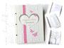 Stammbuch in creme, weiß, rosa und hellgrau; mit Einsteckhüllen und individuellen Drucken, z.B. Stammbaum.