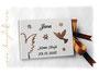Gästebuch zur Taufe in den Farben weiß, dunkelbraun und caramelfarben. Dekoriert mit den Symbolen Engel, Taube und Blumen.