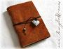Lederbuch rustikal - Weicher Ledereinband mit Kreuzbindung und Lederband mit Accessoires