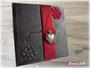 """Tagebuch """"GeheimnisTräger"""" mit einem Einband aus schwarzem Lederimitat und changierendem, roten Stoff"""