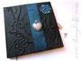 Tagebuch mit Tagebuchschloss - Hardcovereinband mit schwarzem Lederimitat bezogen, gepolsterter Borte aus changierendem, blau-petrolfarbenem Stoff, Relief von Blumen, Blättern und Initialen; Buchblock hellblau DANKE ڿڰ✿ S.O. aus P.