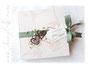 Gästebuch mit Karoband in weiß und grün, Rebenherzen, Perlen und bedrucktem Label.