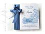 Taufalbum - Fotoalbum 30cm x 30cm, 100 Seiten weiß mit Pergaminzwischenlagen, in den Farben dunkelblau, weiß und aquablau. Symbole: Wal, Baum, Kreuz und Herz.