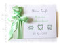 Foto-Gästebuch Taufe - 21cmx16cm, 20 Blatt weiß, mit Wunschtext und individualisierbaren Taufsymbolen bedruckter Einband; in den Farben weiß, hellgrau und pastellgrün.