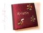 Fotoalbum Feuer & Stein - 30cmx30cm, 100 Seiten weiß, Bezugstoff changierender Crashtaft rot, antikmessingfarbene Buchecken aus Metall, Buchschmuck: Name gestickt, Blumen aus lackierten Steinen.