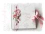 Gästebuch zur Hochzeit oder Taufe, für Fotos und handschriftliche Einträge, mit filigranem Buchschmuck von Rosen, Perlen und Bändern.