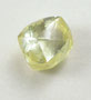 Rough-cut yellow diamond.