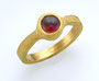 24K gold ring with Mozambique garnet.