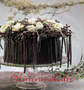 """Brauttischgesteck """"Ranunkeltorte"""" / SMITHERS-OASIS COMPANY Floral Foam. All rights reserved."""