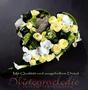 mittelgroßes Blütenherz als persönlicher Abschiedsgruß / SMITHERS-OASIS Company Floral Foam. All rights reserved.