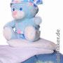 Teddybär mit Kopftuch auf Herz-Körnerkissen