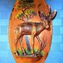 Placa de pared de cobre con el altorrelieve de una springbok