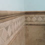 This border is framed by a chair rail and a pencil liner for added architecural depth.