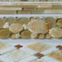 We carry several mosaics that feature Honey Onyx along with other marbles and glass.