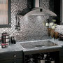 This pebble-shaped stainless steel mosaic backsplash adds an organic touch to an ultramodern kitchen.