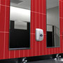 Who said public bathrooms had to be ugly? There's no bolder color combo than red, black, and white.