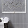 Add fun to dark steely gray tiles with mixed patterns, borders, or mosaics.