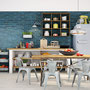 A moody blue-green ceramic wall is just the thing for this charming cafe.