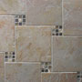 Small sections of a glass and stone mosaic are set with 6x6 ceramic tiles.