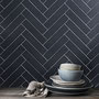 Brighten your dark tiles with a light grout color.
