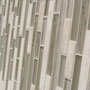 A very popular glass and travertine linear mosaic