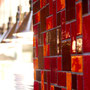 A smoldering blend of reds and oranges simply sets this custom mosaic on fire!