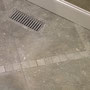 Seagrass limestone floor with a custom heat register.