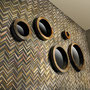 This jazzy herringbone mosaic adds a retro vibe to a feature wall. Why wallpaper when tile looks this good?