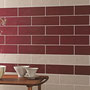 The white grout works with both the wine red and tan tiles, but contrasts more with the red tiles.