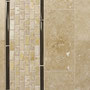 Tuscan Beige travertine with a travertine mini brick mosaic bordered by sable-colored glass pencil liners.