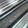 These metallic borders are available in four different finishes and numerous designs.