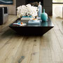 The dark knots and veins in French Oak Blanchie give it the character and depth this clean-edged living room calls for.