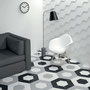 Concentric hexagons in gray, white, and black with a 3D hexagon wall tile for a striking modern aesthetic.