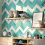 Turquoise and cream in a jazzy herringbone pattern creates life and movement.