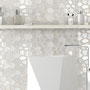This white tile has a cellular pattern with thin gold detailing for a hint of gold in a bright, white bathroom.